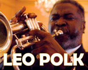 Leo Polk playing the trumpet for The Houstonian's Mardi Gras Masquerade Party.
