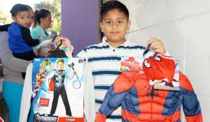 One of the many children that 10/31 Consortium has helped with their annual Halloween costume drives.