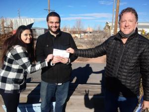 $10,000 winner Anthony Kneisser receives his check from Great U.S. Treasure Hunt organizer Jeff Kessler, who traveled to Santa Fe to award the prize