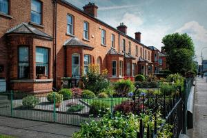 Redbrick terraced houses in the UK with front gardens