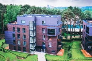 A new build block of flats surrounded by green space
