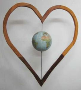 Sculpture of spinning globe inside a heart by Robert Markey of MA.