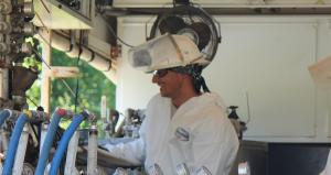 technician monitors chemical injection for environmental remediation