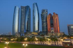 Skyscrapers of Abu Dhabi at night with Etihad Towers buildings. Abu Dhabi is the capital and the second most populous city of the United Arab Emirates.