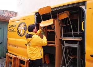 Volunteer Ministers from the Church of Scientology of Padua filled their bright yellow van with desks and chairs to help for a school in Glina damaged by the earthquake.