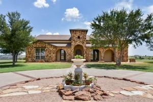 "3,670± sq. ft. 4 bedroom 3 bath, 3 car garage home on 1.9± acres,"" said Ryan Rickles, auction agent.  ""Notable features include a bonus room; storm shelter; kitchen w/conveying stainless Wolf appliances, subzero fridge and wine room"