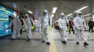 A team disinfects a common area in China