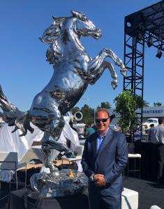 Mark Russo at Monterey Jet Center, California in front of ten foot tall stainless steel rearing stallion