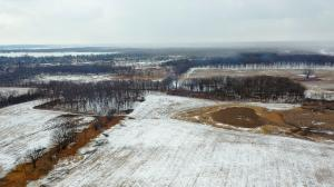 "alt=""Aerial view with snow of 180-acre research project area at Grant Woods in Ingleside, Ill."""