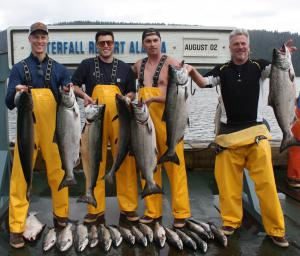 Dan Traub, Sam Traub, Nicholas Berardi and Craig Ode share their salmon catch at Waterfall Resort Alaska.