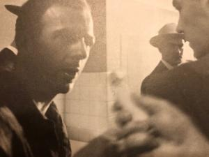 Lee Harvey Oswald attempts to answer a question from a reporter on November 22, 1963. Photograph by James Patrick Murray