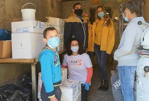 Scientology Volunteer Ministers and CEDEK carry out a joint project to donate supplies to a Roma baker who is providing a way out of poverty to marginalized children