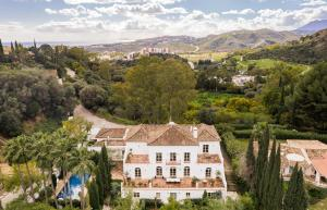 Located in the exclusive gated community of Puerto del Almendro, this French-inspired estate offers unparalleled privacy in the heart of Costa del Sol.
