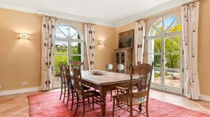 Linger around the breakfast nook or enjoy the formal dining room with French doors leading to the terrace dripping in wisteria for a magical indoor/outdoor experience.