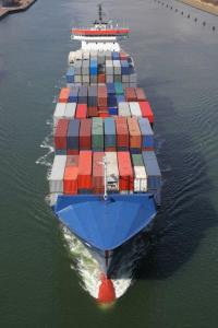 Ship carrying containers of commodities.