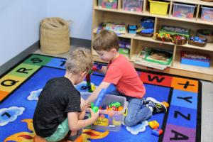 boys playing together in preschool classroom