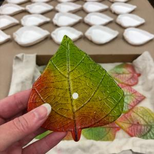 One of 200 colourful cast glass aspen leaves for the Frasier Retirement Donor Appreciation Wall