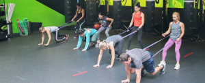A coach helps Pulse Fitness HP members to level up their fitness.