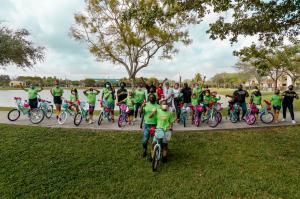 Embrace Girls Foundation members enjoy new bicycles with supporter and Interior Designer Steven G.