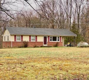 Solid 3 BR/1.5 BA ranch style home on 1.62 +/- acres -- Carport & storage sheds -- Great investment opportunity!!