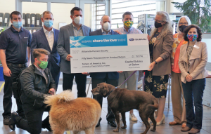 Capitol Subaru and Subaru of America present a check to the Willamette Humane Society of $57,716