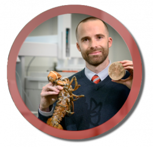 Pictured holding an American Lobster and OrganoBait™, a synthetic and sustainable alternative bait that attracts crustaceans funded by the National Science Foundation, North Carolina Sea Grant and One N.C. Small Business Program.