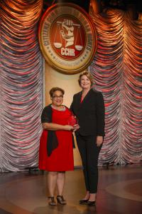 The president of the Florida chapter of CCHR presented attorney Carmen Miller with the 2018 Humanitarian Award for her work to educate citizens on their rights under the mental health law.