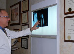 Dr Leonard Marchinski, Orthopaedic Doctor, reviewing x-ray