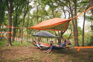 The tree tents are well equipped with blankets, towels, and sleeping bags included to comfortably fit two.