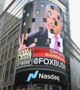 Financial advisor marketer Clint Arthur on the Nasdaq Jumbotron in Times Square, New York City