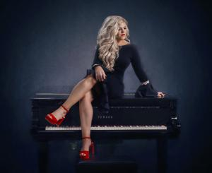 Jennifer Thomas on her piano
