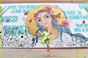 Kendall Jenner stands in front of the complete mural in Williamsburg.
