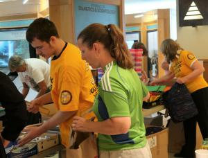 Volunteers from the many community groups supporting the drive gathered at the Church of Scientology Seattle to ready the backpacks for their future owners.