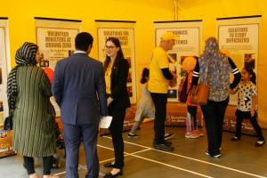 Scientology Volunteer Ministers Canadian Cavalcade welcomes visitors to its bright yellow pavilion.