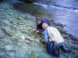 Dr Paul Scofield and amateur palaeontologist Leigh Love examine a section of riverbank on the Waipara River, near where the Protodontopteryx fossil was found.