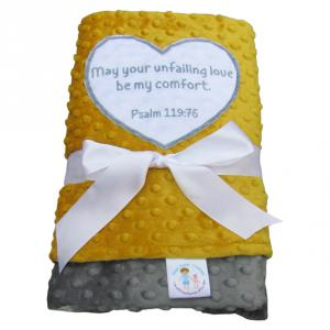 Crib size blanket with ultra soft minky on both sides, and Psalm 119:76 Bible verse applique.  Colors include golden yellow, gray, and white.