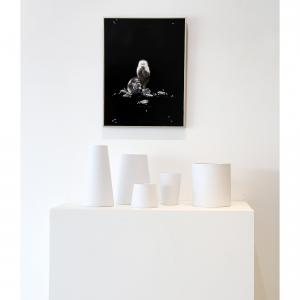 This is a photo of a painting by Linda Cosgrove of a monkey sitting with vases designed by Barbara Barry