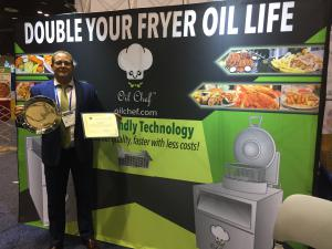 OiL Chef CEO Sean Farry with Award at Restaurant show 2019