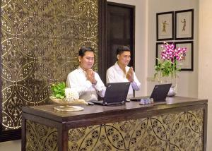 two men doing the welcome gesture of Cambodians