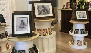 Art displays along with copies of various Youth for Human Rights educational materials so people could follow along with the 30 human rights as they looked at art on each topic.