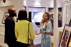 Director of the National Office of Youth for Human Rights discusses the importance of human rights education while giving a tour of the exhibit to two attendees.