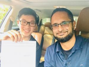 Shayraz Khan of Tomorrow's Drivers and a student who passed their Ontario G/G2 road test