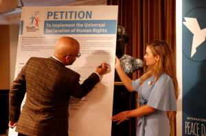 Guests signed a petition to mandate human rights education in schools.