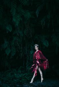 EMPRESS looks ethereal walking through the forest in heels and adorned with a crown.