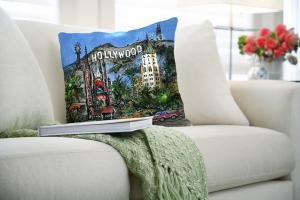 Sumptuous Hollywood Pillow with Beverly Hills Hotel in fun cityscape on a couch