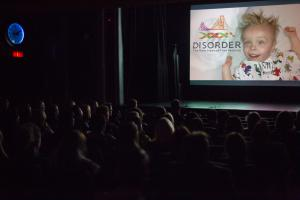A scene form our 2017 festival a full house crowd watches films at Disorder the Rare Disease Film Festival